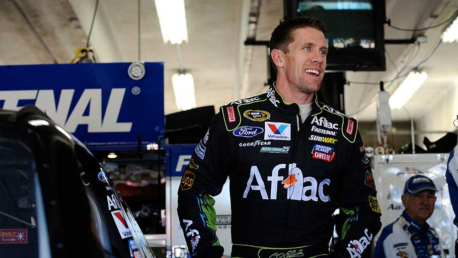 Carl Edwards laughs in the garage