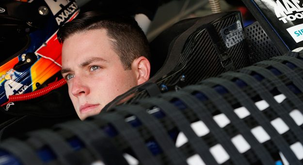 Alex Bowman, driver of the No. 88 Axalta Chevrolet, sits in his car during practice.