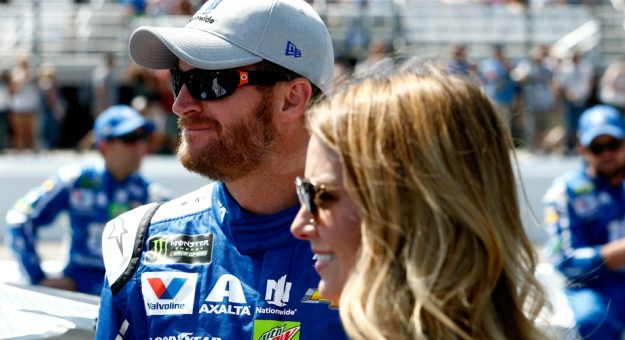 Dale Jr. and wife Amy participate in pre-race ceremonies