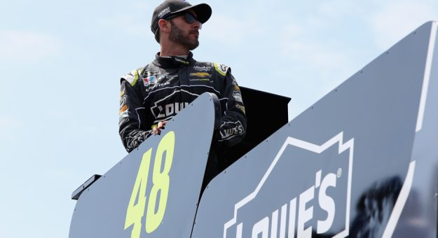 Jimmie Johnson stands on his pit box ahead of a Dover practice