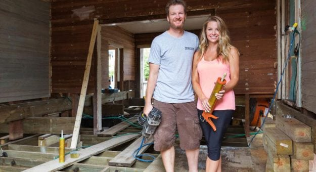 Dale Jr. and Amy Earnhardt pose in a Key West house they are renovating for DIY Network.