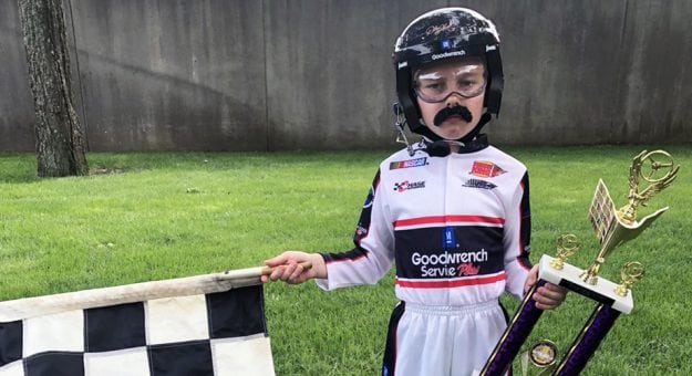 A child dressed up as Dale Earnhardt.