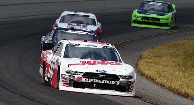 Cole Custer's No. 00 Ford leads a small pack out of Turn 3 at Pocono Raceway
