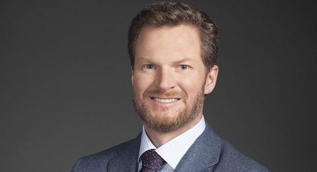 Dale Earnhardt Jr. poses in a suit