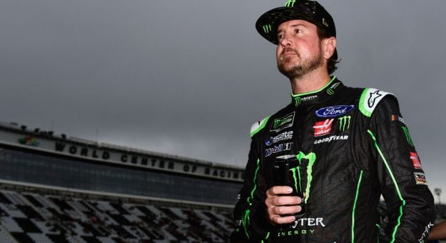 Kurt Busch stands on the grid at Daytona.