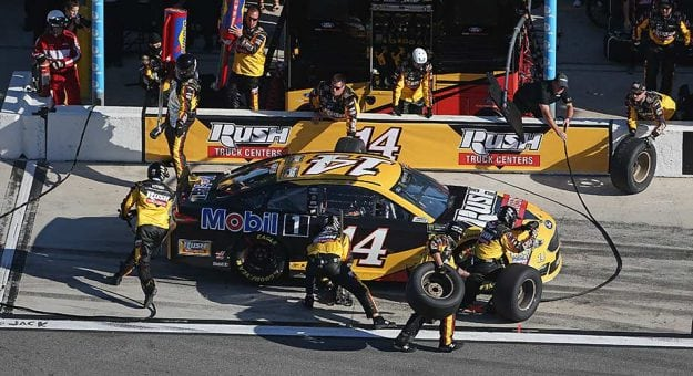 Clint Bowyer's pit crew provides service during a stop at Daytona International Speedway.