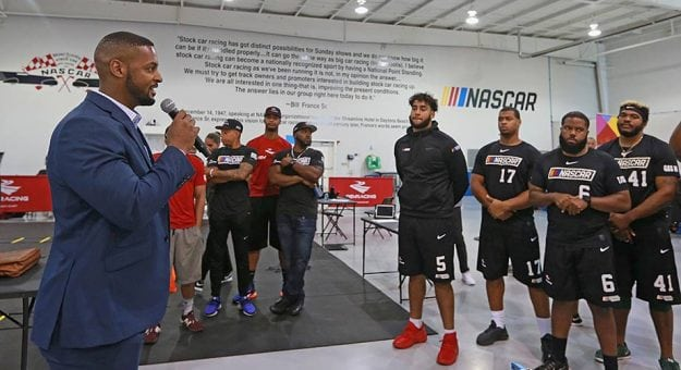 Jusan Hamilton addresses participants in the NASCAR Drive for Diversity Pit Crew Combine in May.