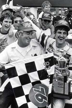 Davey Allison pours beer on his dad Bobby's head