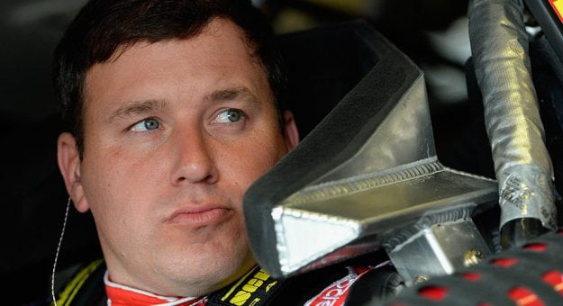 Closeup of Ryan Newman strapped into his car