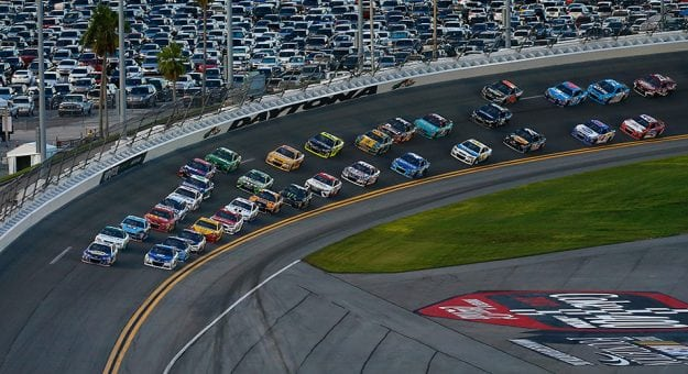 The Monster Energy Series field comes out of Turn 4 at Daytona.