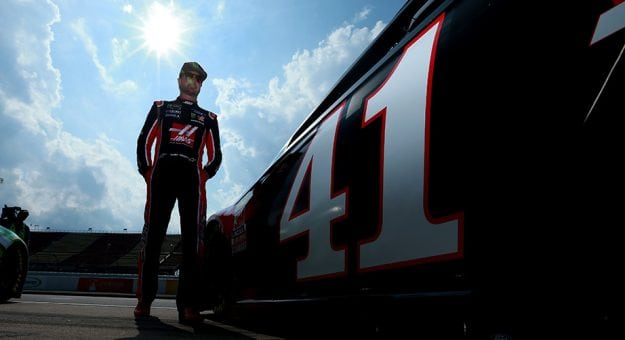 Kurt Busch stands near the No. 41 car during qualifying at Michigan.
