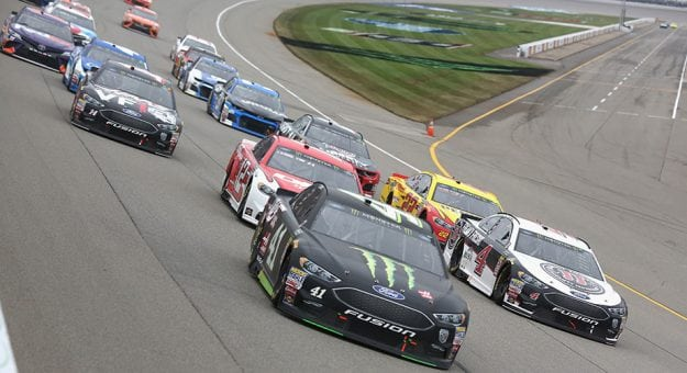Kurt Busch leads the Monster Energy Series field into Turn 1 at Michigan International Speedway.