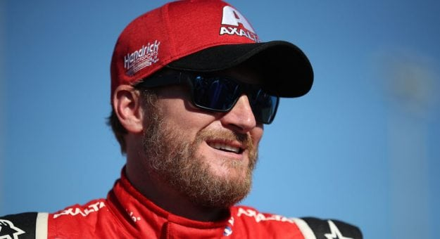 Dale Earnhardt Jr. looks on from the garage in his last Monster Energy Series race in Homestead.