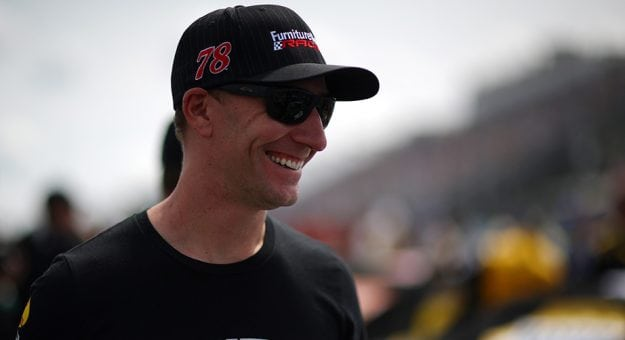 Cole Pearn smiles in the garage