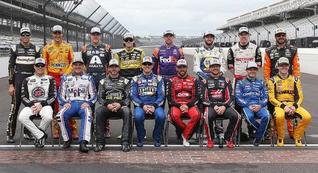 The Monster Energy Series' field of 16 playoff drivers poses on the frontstretch at Indianapolis Motor Speedway.