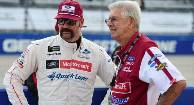 Paul Menard stands on the grid at Darlington with Leonard Wood