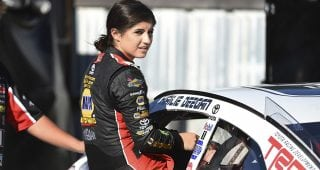 Hailie Deegan climbs out of her car.