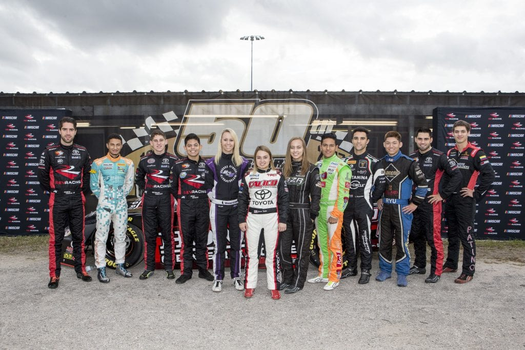 NEW SMYRNA BEACH, FL - OCTOBER 23: Left to right, Ruben Garcia Jr., of Mexico, Ernie Francis Jr., Nick Sanchez, Ryan Vargas, Brooke Storer, Gracie Trotter, Brittney Zamora, Juan Manuel Gonzalez, of Mexico, Loris Hezemans, of the Netherlands, Ryu Taggart, Chase Cabre, and Perry Patino pose for a group shot, NASCAR Drive for Diversity Combine, at New Smyrna Speedway on October 23, 2018 in New Smyrna Beach, Florida. (Photo by Brian Cleary/Getty Images) | Getty Images