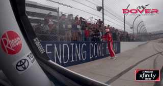 Bell follows in Blaney's footsteps, hands checkered flag to fan