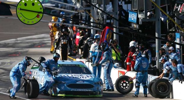 Kevin Harvick's pit crew goes to work during a stop in Phoenix.