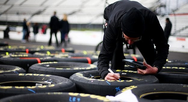 A Hendrick Motorsports crewmember checks over tires for the No. 88 Chevrolet at Martinsville Speedway.