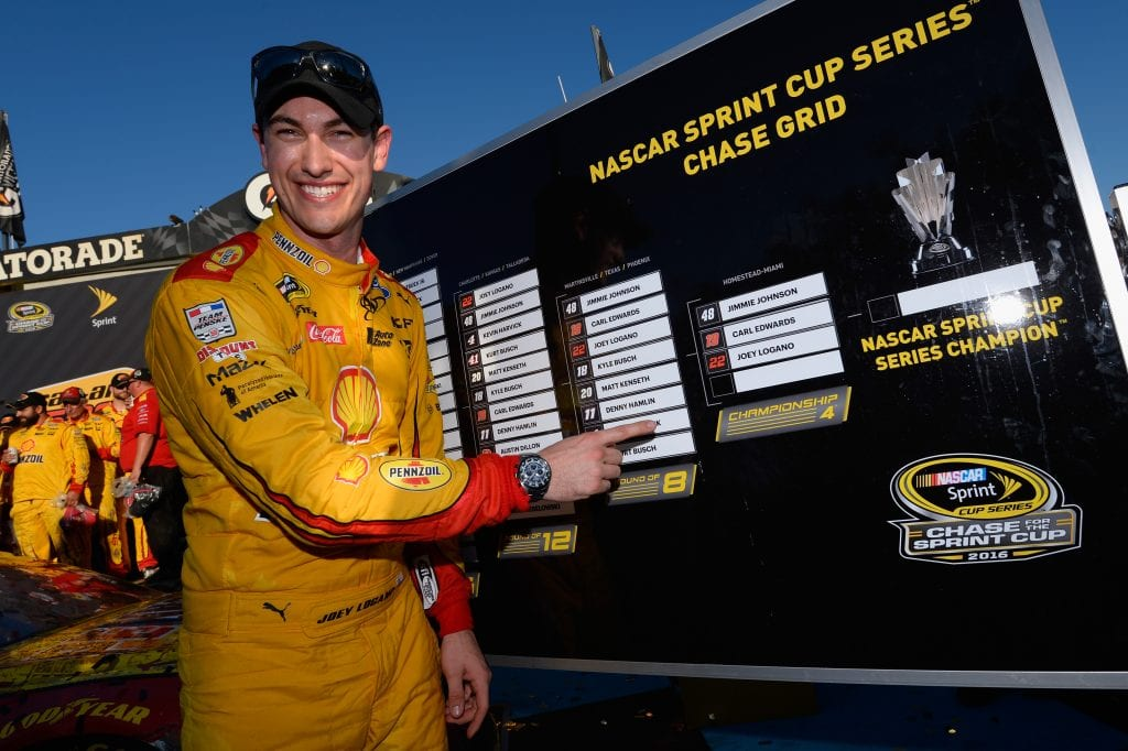 AVONDALE, AZ - NOVEMBER 13: Joey Logano, driver of the #22 Shell Pennzoil Ford, poses with his name in the Championship Four of the Chase Grid in Victory Lane after winning the NASCAR Sprint Cup Series Can-Am 500 at Phoenix International Raceway on November 13, 2016 in Avondale, Arizona. (Photo by Robert Laberge/NASCAR via Getty Images)