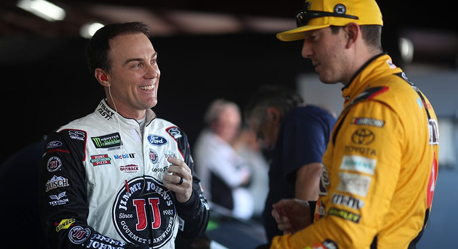 Kevin Harvick and Kyle Busch talk in the garage at Talladega.