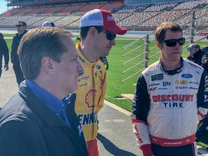 Joey Logano, Brad Keselowski and crew chief Todd Gordon gather at the Team Penske pit crew competition at Charlotte Motor Speedway.