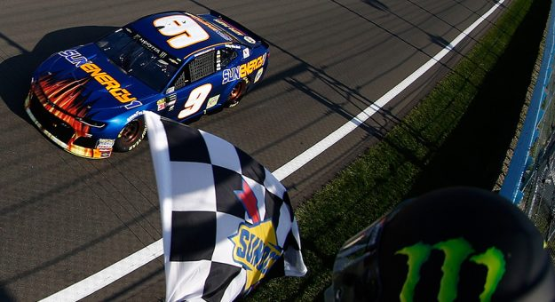 Chase Elliott takes the checkered flag at Watkins Glen in 2018.
