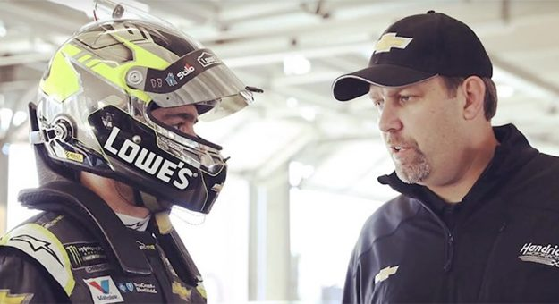 Jimmie Johnson and Kevin Meendering chat during a test session.