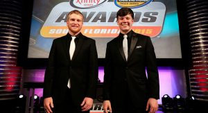 Chris Buescher and Erik Jones smile at the awards ceremony in 2015/