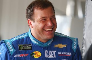 Ryan Newman shares a smile in the garage.