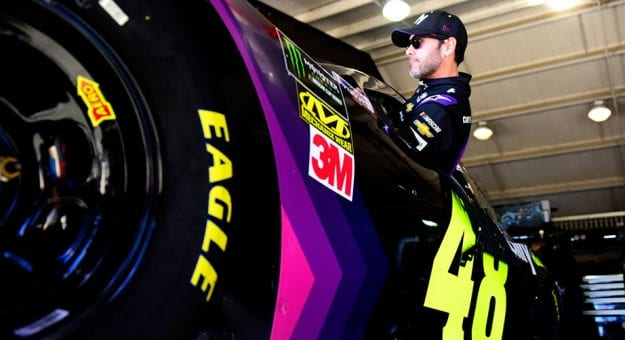 Jimmie Johnson climbs into the No. 48 Chevrolet at Auto Club Speedway.