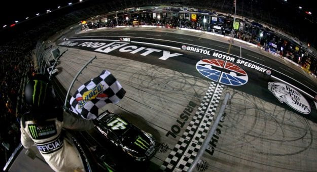 BRISTOL, TN - AUGUST 18:  Kurt Busch, driver of the #41 Monster Energy/Haas Automation Ford, takes the checkered flag to win the Monster Energy NASCAR Cup Series Bass Pro Shops NRA Night Race at Bristol Motor Speedway on August 18, 2018 in Bristol, Tennessee.  (Photo by Sean Gardner/Getty Images) | Getty Images