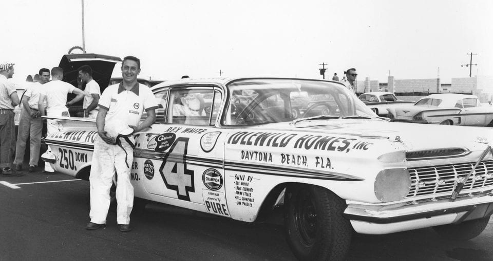 DAYTONA BEACH, FL - FEBRUARY 1959:  Rex White poses with his 1959 Chevrolet that he ran at the first Daytona 500 at Daytona International Speedway. White ended the race in 26th position after suffering an engine failure on lap 174. His winnings: $100. (Photo by ISC Images and Archives via Getty Images)