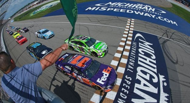The green flag flies on a race at Michigan International Speedway.