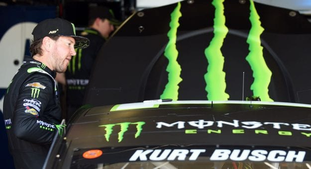 Kurt Busch gets into his car in Michigan