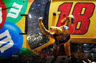 DAYTONA BEACH, FL - FEBRUARY 18:  Kyle Busch, driver of the #18 M&M's Brown Toyota, celebrates in victory lane after winning the NASCAR Budweiser Shootout at Daytona International Speedway on February 18, 2012 in Daytona Beach, Florida.  (Photo by Tom Pennington/Getty Images for NASCAR) | Getty Images