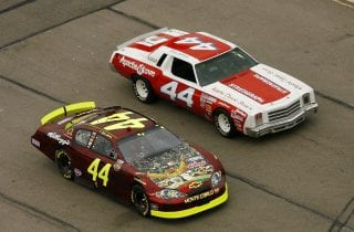 FORT WORTH, TX - NOVEMBER 05:  Terry Labonte (L), driver of the #44 Kellogg's Chevrolet and his son Justin (R) driving the race car Terry won his first race with, lead a pace lap during the NASCAR Nextel Cup Series Dickies 500, on November 5, 2006 at Texas Motor Speedway in Fort Worth, Texas.  (Photo by Chris Graythen/Getty Images for NASCAR) | Getty Images