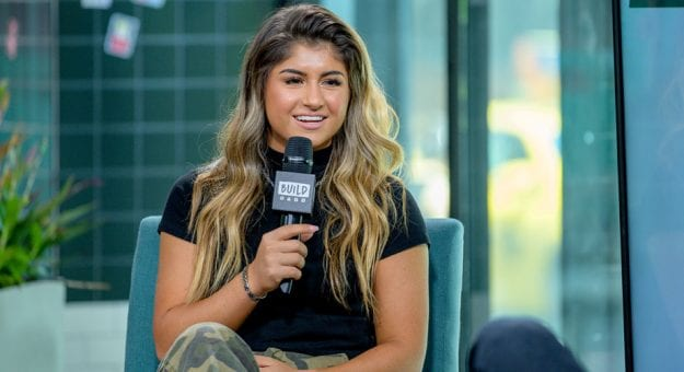Hailie Deegan speaks at a NASCAR event