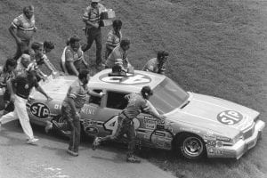DAYTONA BEACH, FL - JULY 4, 1984: The Petty Enterprises crew pushes Richard PettyÕs car to victory lane following his 200th career NASCAR Cup win in the Firecracker 400 at Daytona International Speedway. (Photo by ISC Images & Archives via Getty Images)