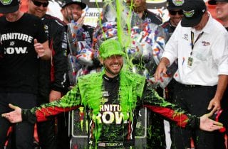 JOLIET, IL - SEPTEMBER 17:  Martin Truex Jr., driver of the #78 Furniture Row/Denver Mattress Toyota, celebrates in victory lane after winning  during the Monster Energy NASCAR Cup Series Tales of the Turtles 400 at Chicagoland Speedway on September 17, 2017 in Joliet, Illinois.  (Photo by Brian Lawdermilk/Getty Images) | Getty Images