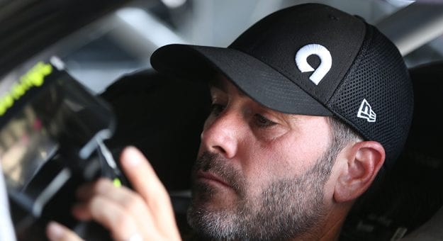 Jimmie Johnson sits in his car preparing to drive.