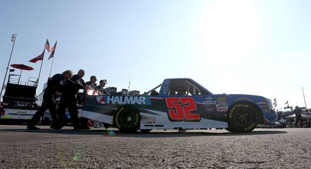 The crew pushes the No. 52 truck