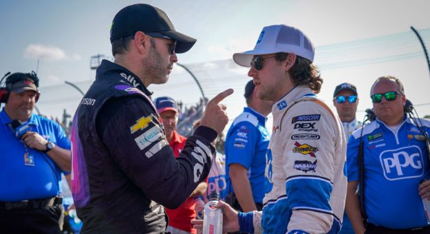 Jimmie Johnson talks with Ryan Blaney