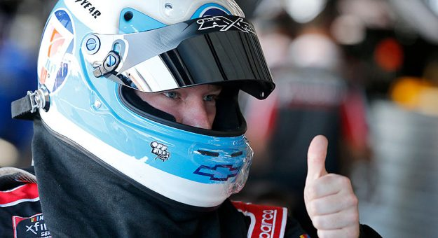 Tyler Reddick offers a thumbs-up in the Darlington Raceway garage.
