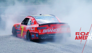 Allgaier slides through Turn 1, gets stuck in gravel trap