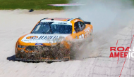 Custer blows through banners at Road America