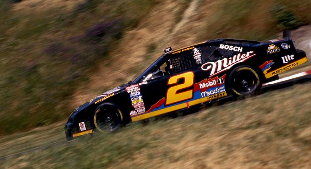 SONOMA, CA - MAY 05: Rusty Wallace drives the No. 2 Miller Ford, owned by Roger Penske, in the Save Mart Supermarkets 300 road-course race on May 5, 1996 at Sonoma Raceway in Sonoma, California. Wallace went on to win the NASCAR Sprint Cup Series race. (Photo by ISC Archives and Research Center via Getty Images)
