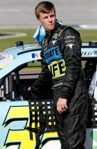 TALLADEGA, AL - APRIL 27: Joey Gase, driver of the #35 DnteLife/RgistrMe.org/Cmpgn/Gase Toyota, stands by his car during qualifying for the NASCAR Xfinity Series MoneyLion 300 at Talladega Superspeedway on April 27, 2019 in Talladega, Alabama. (Photo by Brian Lawdermilk/Getty Images) | Getty Images